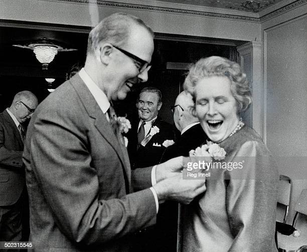 Flowers for a foe They may be arch political foes but mayoralty hopeful Margaret Campbell is all smiles as Mayor William Dennison pins on a corsage...
