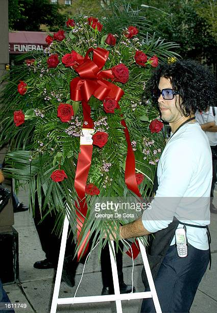 Flowers for deceased RB singer Aaliyah arrive at the Frank E Campbell funeral home August 30 2001 in New York City on the day before the young...