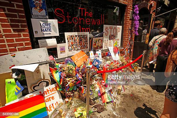 Flowers for Orlando outside Stonewall Inn Mayor Bill de Blasio joined members of the NY city council National Parks Service dept of the interior and...