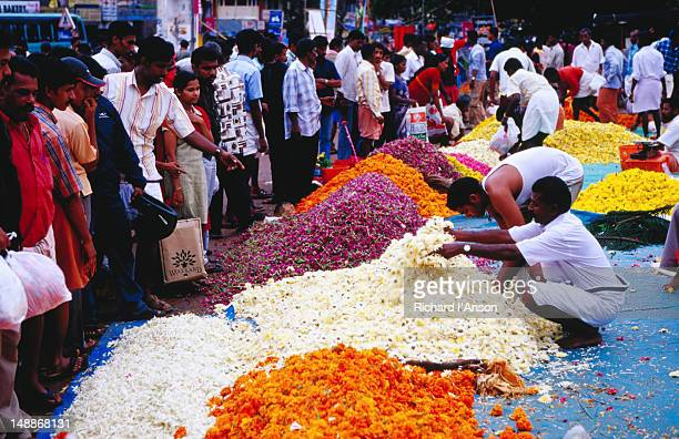 Flowers for sale at street market on the eve of the Onam festival.