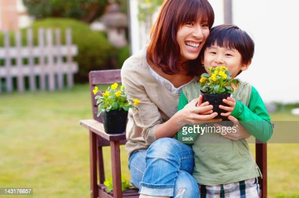 flowers for you - japan mom and son stock photos and pictures