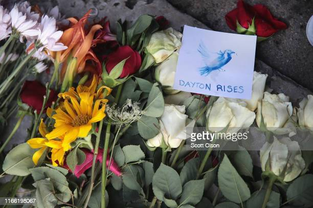 Flowers form a small memorial in front of a bar in the Oregon District following yesterday's mass shooting on August 05, 2019 in Dayton, Ohio. Nine...