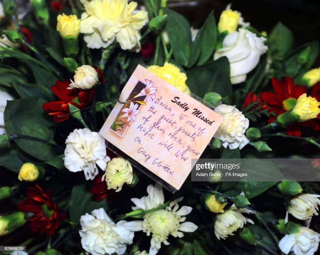 Flowers from gary glitter sit outside the most holly name catholic connolly funeral flower glitter news photo izmirmasajfo