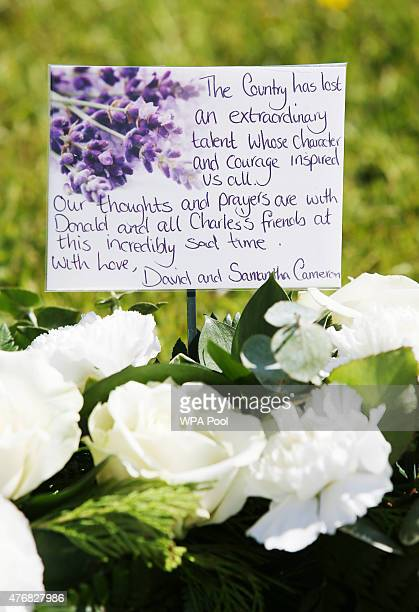 Flowers from Prime Minister David Cameron and his wife Samantha are placed outside St John's Roman Catholic Church for the funeral of former Liberal...