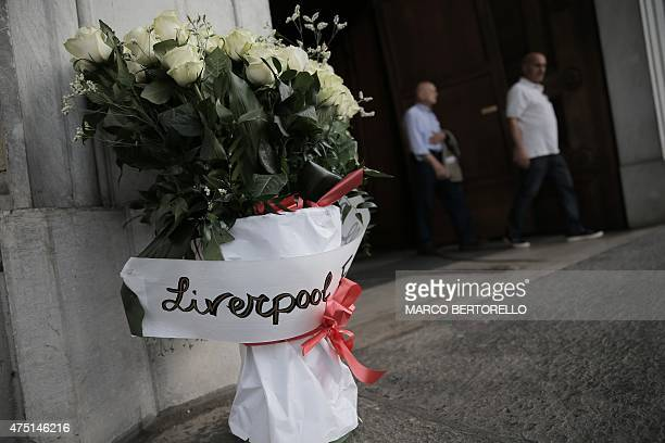 Flowers from the Liverpool football club are pictured outside Gran Madre di Dio church in Turin on May 29 during a mass to mark the 30th anniversary...