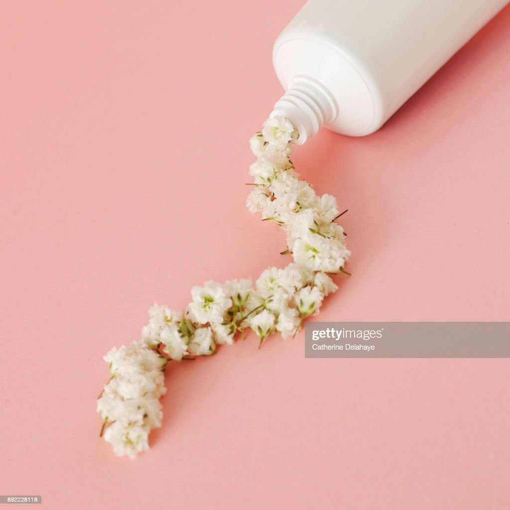 Flowers game still life on pink background