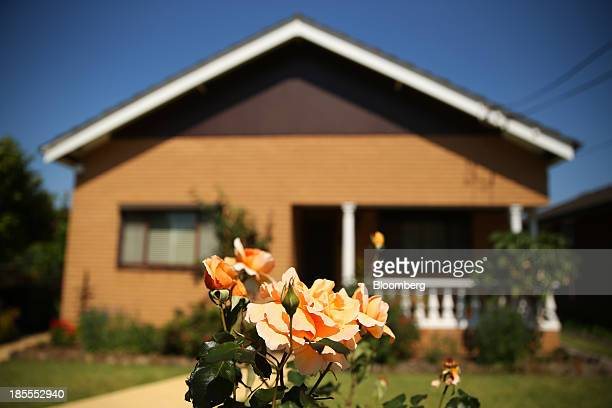 Flowers grow in the front yard of a house in the suburb of Willoughby in Sydney Australia on Saturday Oct 19 2013 Home prices across Australia's...