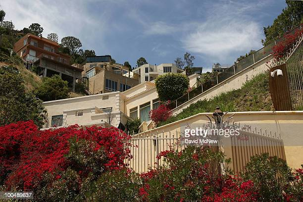 Flowers grow outside the home of Simon Monjack after he was found dead by his motherinlaw on May 24 2010 in Hollywood California Monjack was the...