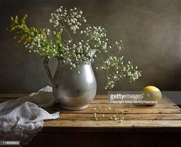 Flowers gypsophila in alluminium pitcher, lemon