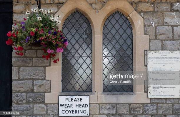 Flowers hang next to signs outside the entrance to the prayer hall of the funerary buildings at Willesden Jewish Cemetery also known as the United...