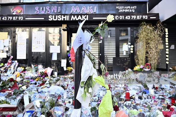 Flowers have been laid at a memorial at the site of the attack at a Japanese restaurant near the Cafe Belle Equipe on rue de Charonne in the 11th...