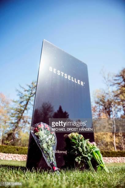 Flowers have been laid at the sign of Danish fashion business Bestseller in Brande Denmark on April 22 2019 to pay tribute following the attacks in...