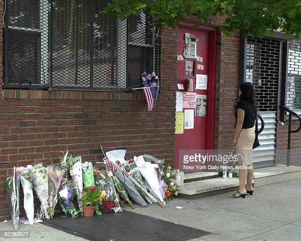 Flowers have been placed in memory against the wall and sympathy notes have been attached to the door of the Bergin Hunt and Fish Social Club in...