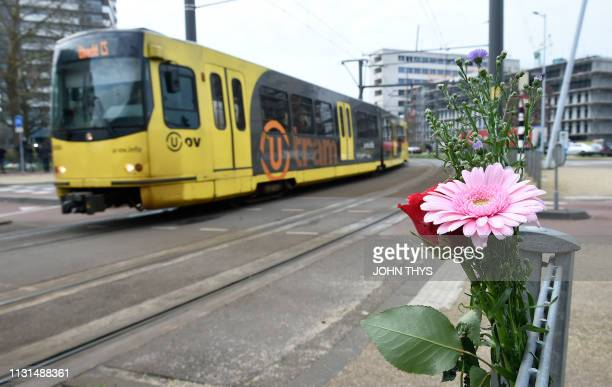Flowers have been set up in tribute to victims at the site of a shooting in a tram at 24 October square in Utrecht on March 19 one day after three...