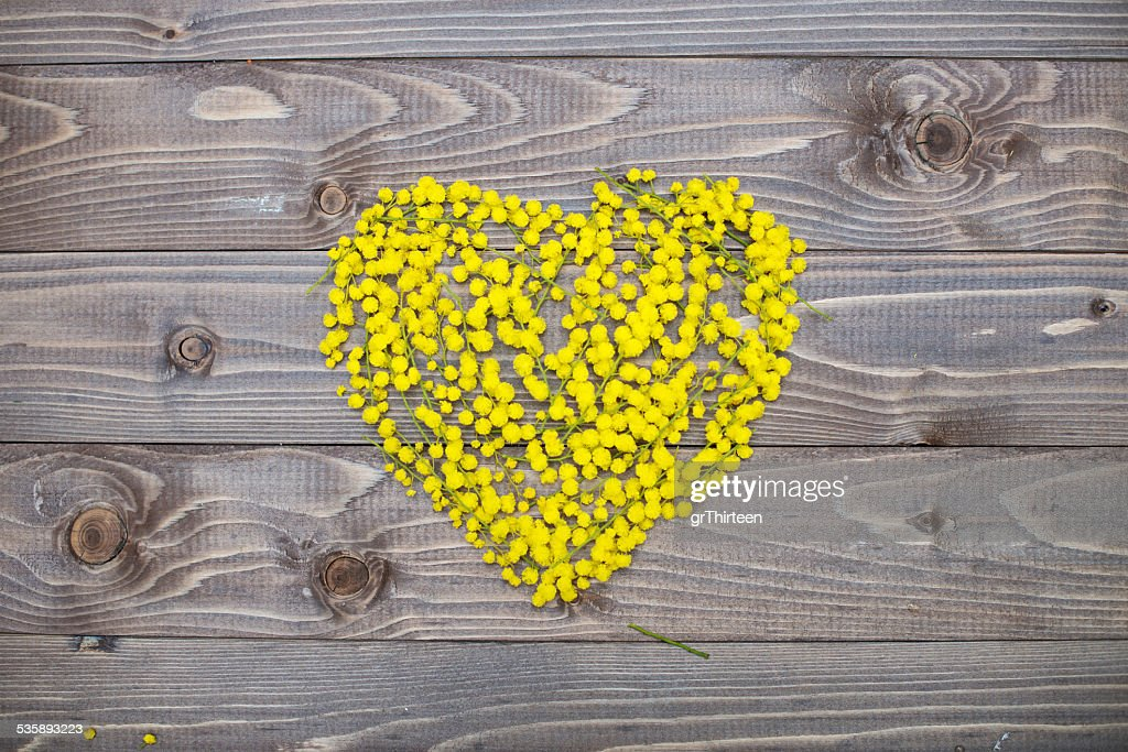 flowers heart on wood panel. Valentines background. : Stock Photo