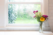 Flowers in front of window - high key with copyspace