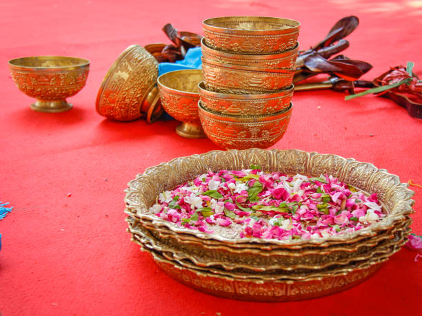 Flowers In Plate With Bowls On Table