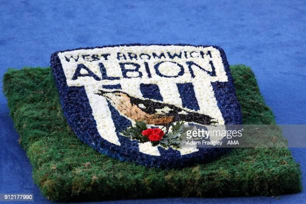 Flowers in the form of the West Bromwich Albion crest / badge during the Cyrille Regis Memorial Service at The Hawthorns at The Hawthorns on January...