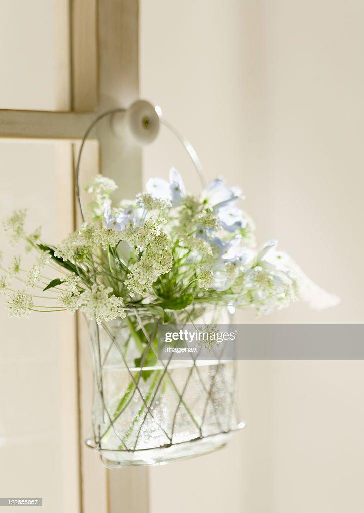 Flowers In The Hanging Basket On Door