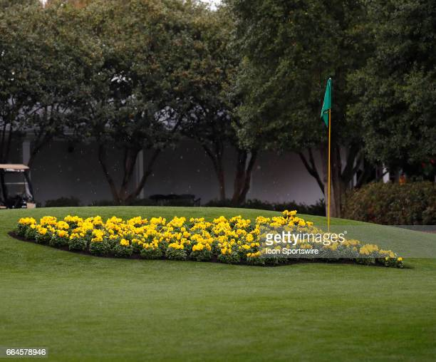 Flowers in the shape of the Masters logo are in bloom in front of the clubhouse during the first day of practice for the 2017 Masters Tournament on...