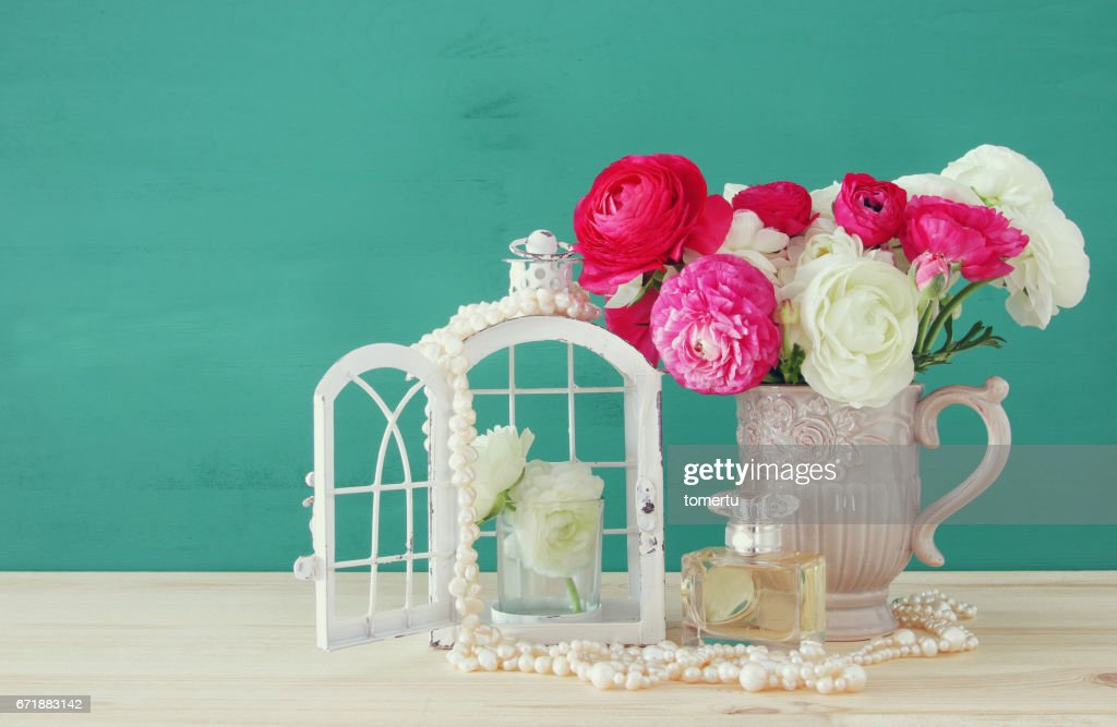 Flowers In The Vase Next To Pearls Necklace And Perfume Bottle Stock