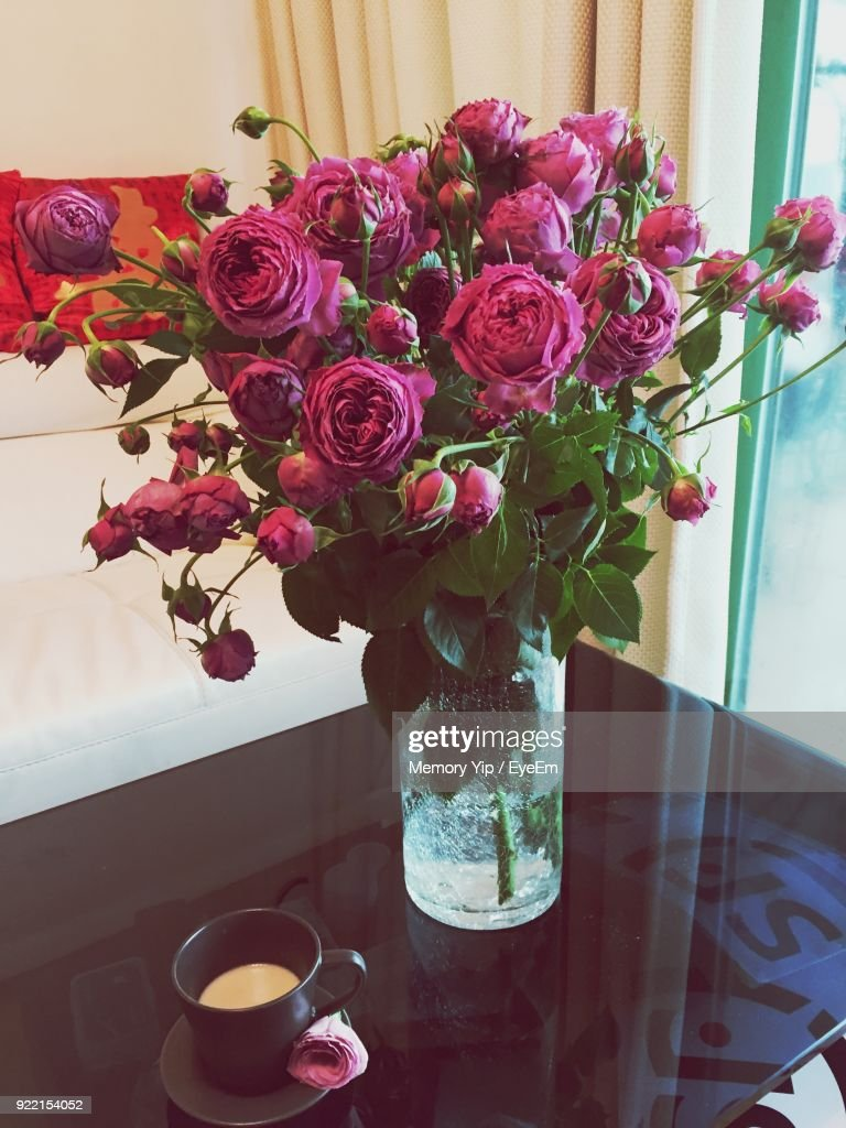 Flowers in vase by coffee cup over table stock photo getty images flowers in vase by coffee cup over table reviewsmspy
