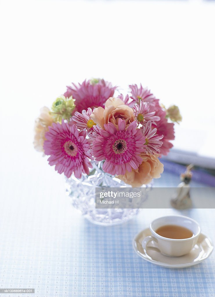 Flowers In Vase Next To Tea Cup Stock Photo Getty Images