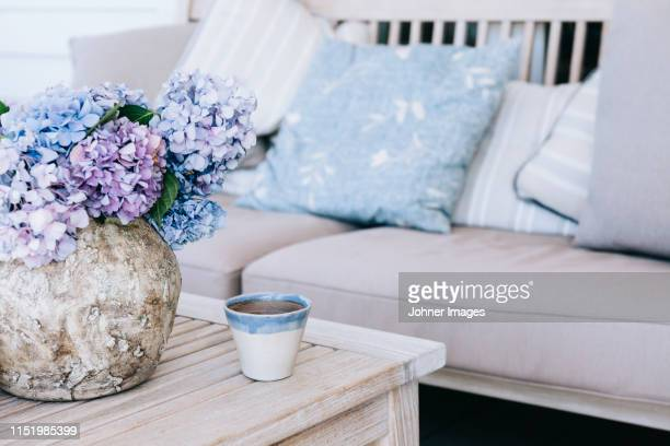 flowers in vase on table - hydrangea stock pictures, royalty-free photos & images