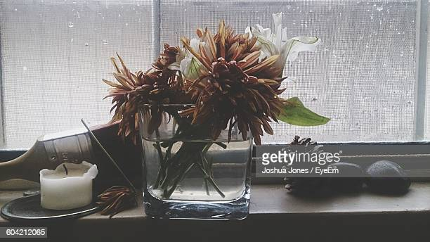 Flowers In Vase On Window Sill During Monsoon