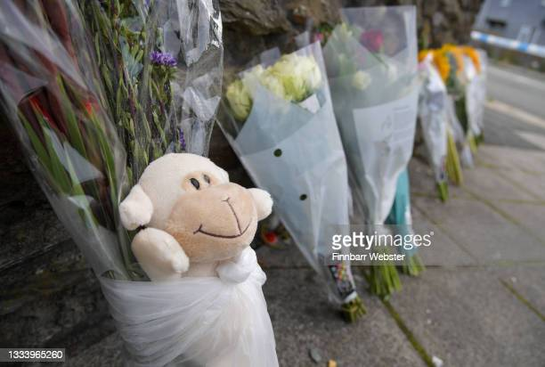 Flowers laid at Royal Navy Avenue on August 13, 2021 in Plymouth, England. Police were called to a serious firearms incident in the Keyham area of...