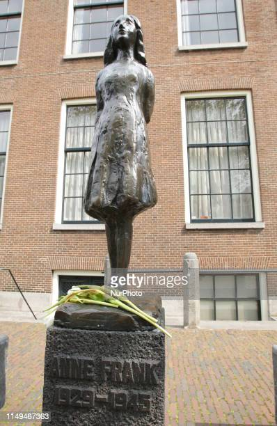 Flowers laid at the Anne Frank statue to remember Anne Frank's 90th Birthday on June 12 2019 in AmsterdamNetherlands Today it is exactly 90 years ago...