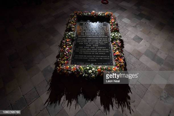 Flowers laid by Queen Elizabeth II and German President Dr Frank-Walter Steinmeier lay together at the grave of The Unknown Warrior after a service...