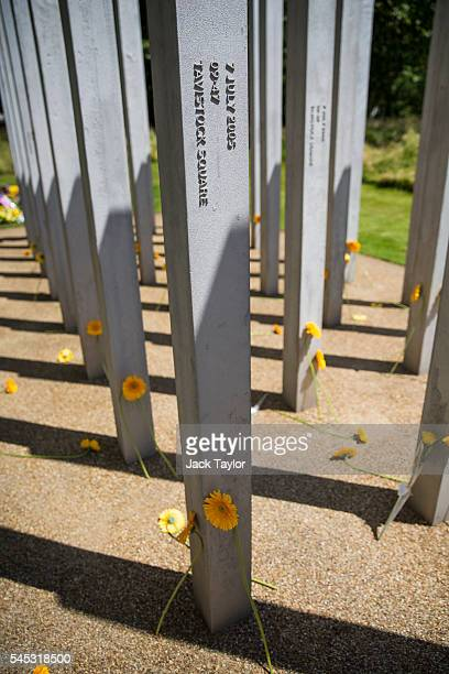 Flowers laid by survivors friends and relatives of the victims of the London bombings at the 7/7 memorial on July 7 2016 in London England Britain...