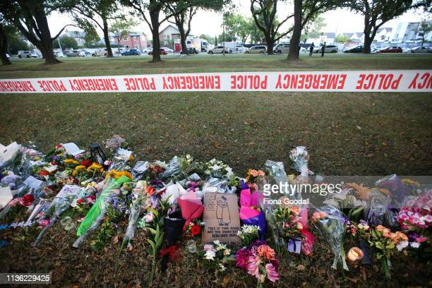Flowers laid in Hagley Park opposite the Al Noor mosque on Deans Rd March 17 2019 in Christchurch New Zealand 49 people are confirmed dead with with...
