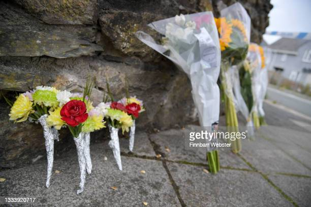 Flowers laid on Royal Navy Avenue on August 13, 2021 in Plymouth, England. Police were called to a serious firearms incident in the Keyham area of...