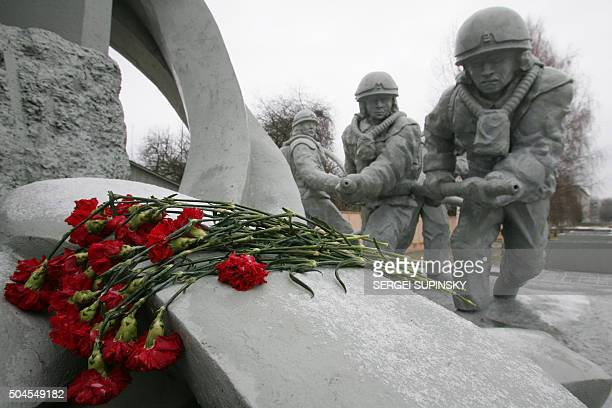 Flowers lay 16 December 2005 at the monument of firemen who died during Chernobyl nuclear disaster in the city of Chernobyl Chernobyl's numberfour...