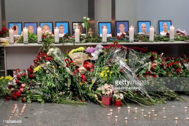 REGION UKRAINE JANUARY 8 2020 Flowers lay at the portraits of nine crew members who were among 176 people on board of the Ukraine International...