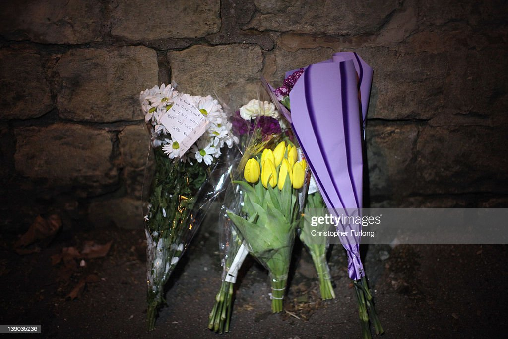 Flowers lay in tribute outside Elmfield Park, Doncaster, following the death of a 13-year-old girl on February 15, 2012 in Doncaster, England. Police investigating the murder are questioning a 26year-old woman who remains in police custody.