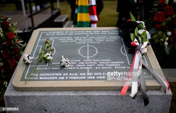 Flowers lay on a memorial stone during a ceremony to commemorate the victims of a plane crash in icy weather 60 years ago in which eight players and...