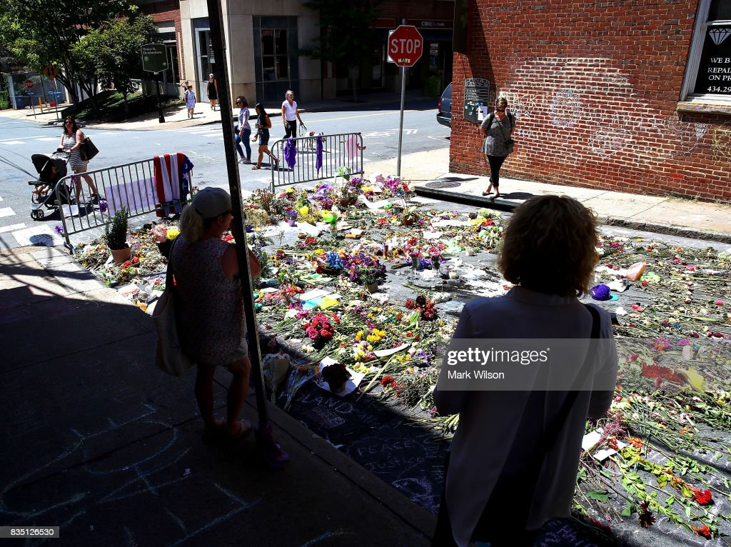 Flowers lay on the street where Heather Heyer was killed and 19 others injured when a car slammed into a crowd of people protesting against a white supremacist rally, August 18, 2017 in Charlottesville, Virginia. A participant in a white nationalist, neo-Nazi rally allegedly drove his car into the crowd of people demonstrating against the 'alt-right' gathering.