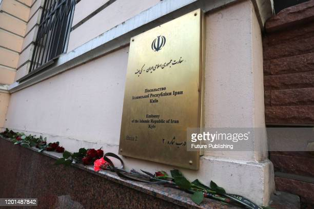 Flowers lay outside the Embassy of the Islamic Republic of Iran during a commemorative action held 40 days after the January 8 downing of the Ukraine...