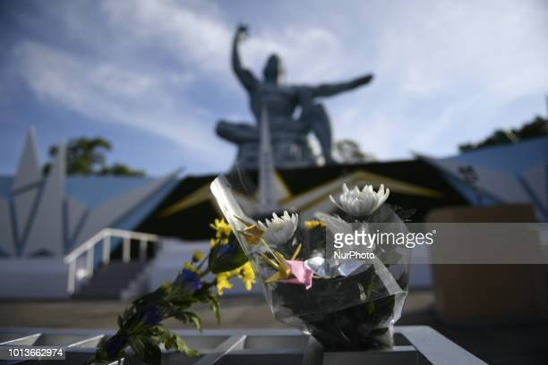 Flowers lays by visitors are seen in front of the Nagasaki Peace Park in Nagasaki southern Japan August 9 2018 during the 73rd anniversary of the...