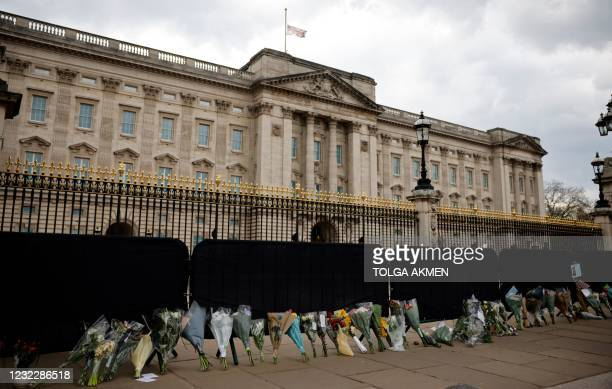Flowers left as tributes are pictured outside Buckingham Palace in central London, on April 13 following the April 9 death of Britain's Prince...