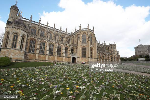 Flowers left as tributes are pictured outside St George's Chapel, at Windsor Castle in Windsor, west of London, on April 16 following the April 9...