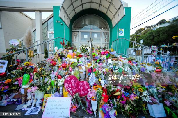 TOPSHOT Flowers left by residents are seen at a memorial site for victims of the Christchurch mosque attacks at an Islamic Center in Kilbirnie...