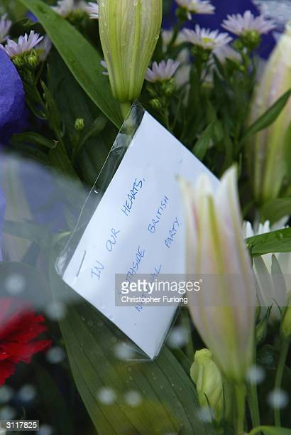 Flowers left by The British National Party are seen where the abduction of Kriss Donald took place, March 21, 2004 in Glasgow. Kriss Donald, a...