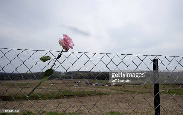 Flowers left by visitors grace the fence overlooking the crash site of Flight 93 following the announcement that Osama Bin Laden had been killed in...