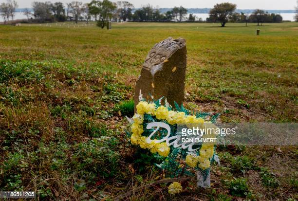 TOPSHOT Flowers left for a father are seen at a grave marker in the Potter's field at Hart Island October 25 2019 in New York Elaine Joseph's baby...