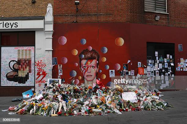 Flowers letters and other items left on a mound continue to grow two weeks after the death of Brixton born English singer songwriter David Bowie at...
