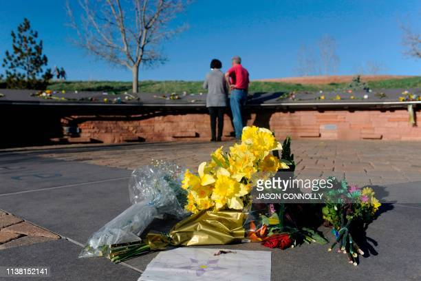 Flowers lie at the center of the Columbine Memorial at Clement Park in Littleton Colorado before a community vigil for the 20th anniversary of the...